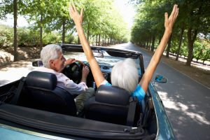 shutterstock_84048223-two-people-in-car-hands-up